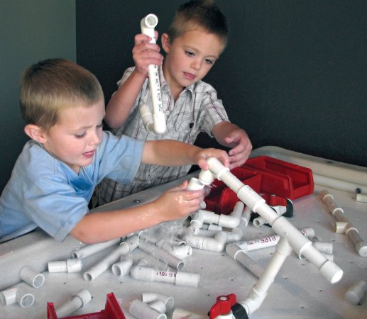 Explora Science Center and Children's Museum of Albuquerque: Being a plumber at Explora in our area about water!