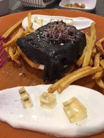 Bacahlau in a black coat with fries.