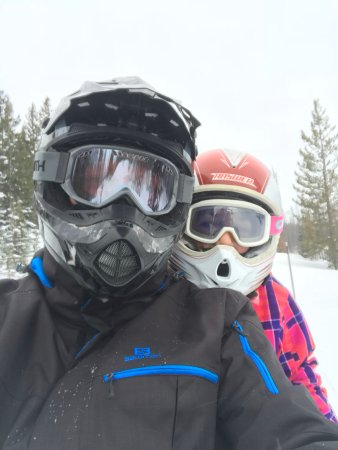 Dubois, WY: Me and my daughter on our rental snowmobile on the awesome trails !