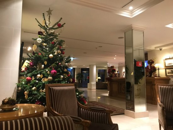 Hotel Royal : The lobby decorated for Christmas, looking towards the entrance, with the front desk on the righ