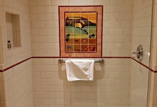 La Fonda on the Plaza: Walk-in shhower with custom tile work is an example of how local art plays into the hotel's them
