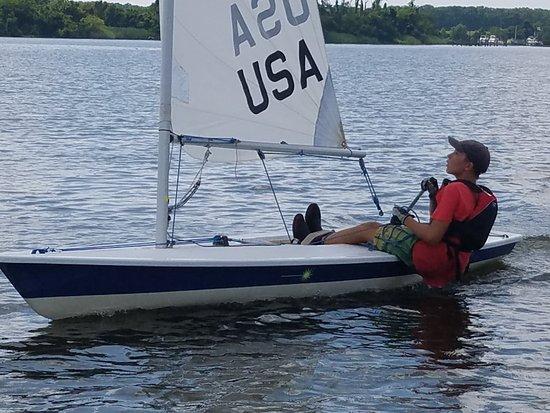 Rock Hall, MD: A seasoned laser sailor trimming his sail