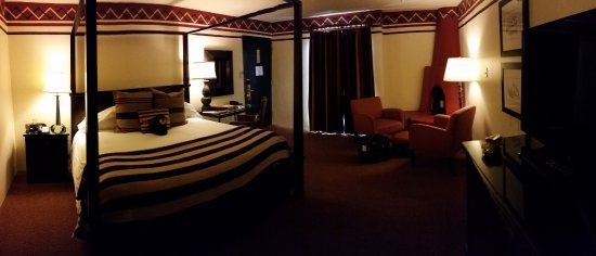 Inn and Spa at Loretto: My room with sitting area by kiva fireplace (private sun terrace behind curtain.)