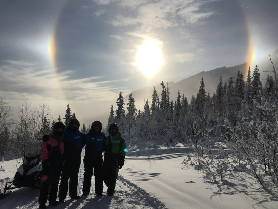 Rocky Mountain Riders Snowmobile Tours and Rentals: Finn took this picture of us with Sun Dog in background!