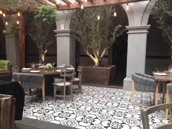 Hacienda de Guadalupe Boutique Hotel : Open Area for dining, having a glass of wine or sitting.
