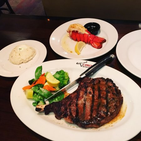 Shows a big hunk of steak with vegetables