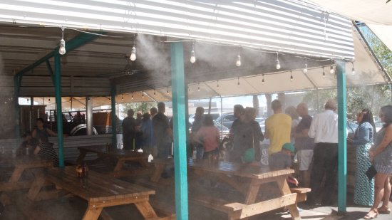Little Miss Bbq: A view of the line up, misters, and outdoor seating area