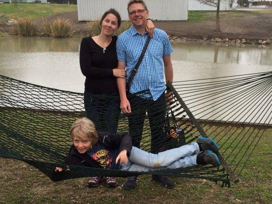 Raceland, LA: Family from France enjoy the hammock along the bayou.