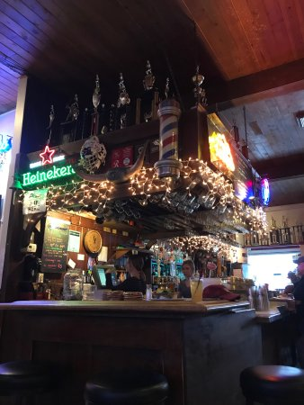 The Tav : Interior packed with softball and golf trophies.