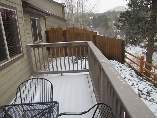 Beaver Brook on the River: View of balcony. Fence off to side of balcony is of hot tub area.