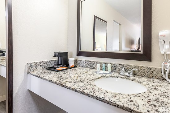 Quality Inn West Palm Beach Airport King Sofa Guest Bath Vanity