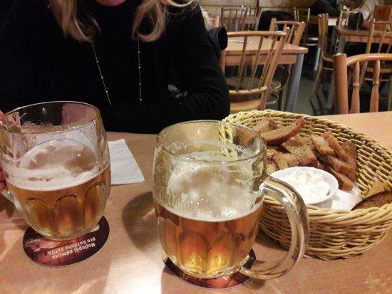 "Restaurace U Havrana: Pilsner Urquell beers + ""Havranovy tyčinky"" (hot breadsticks rubbed with garlic + sauce)"