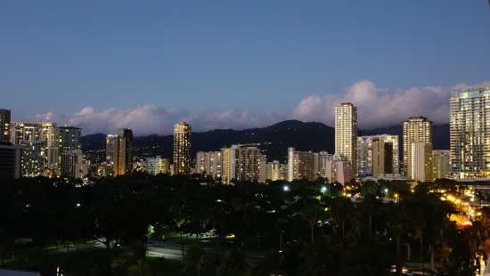 Waikiki Shore: Night skyline from our room. See how the large park area creates privacy for those on the balcon