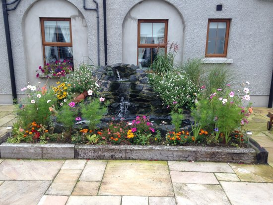 Moira, UK: Water fall in our Garden and cottage flowers planted for sumer colour.