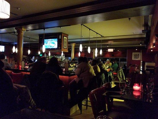 Malden, MA: Interior view at night from rear corner of dining room (center bar)