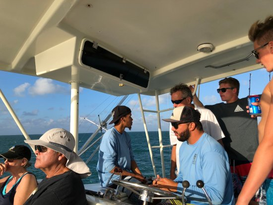 George Town, Grand Cayman: Capt Jonathan and First Mate Lee showing the boys the equipment