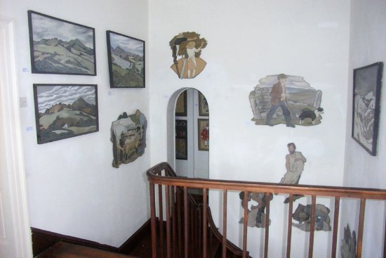 Caersws, UK: Maesmawr Farmhouse B&B staircase with art show