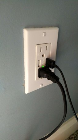 Russellville, KY: One of the electrical outlets with dual USB charging ports in the June Room