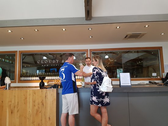 Marlborough Elite Tours - Day Tours: Lovely honeymoon couple at Cloudy Bay Winery on private tour