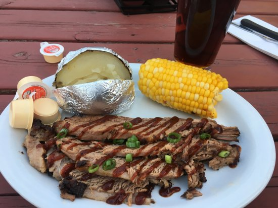 The Fire Pit BBQ Smokehouse: Brisket, baked potato, and corn.