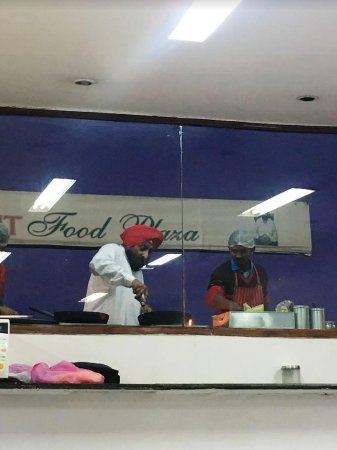Surjit Food Plaza: Surjit- cooking himself