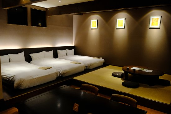 Karuizawa Hotel Longing House: spacious triple room with tatami sitting area and dining area