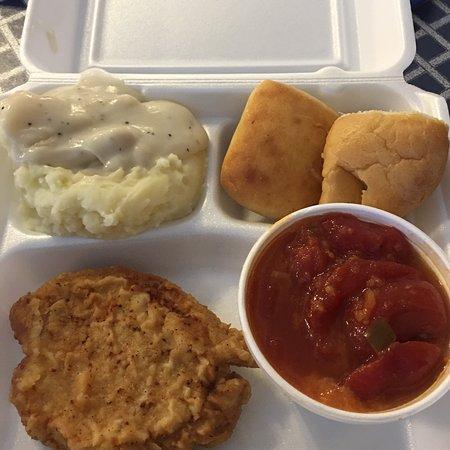 Jeffersonville, IN: Fried pork tenderloin, mashed potatoes w/white gravy, stewed tomatoes, and rolls.