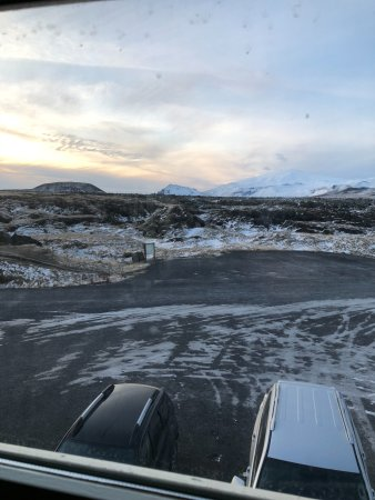"""Budir, Islandia: Dirty window and the view to the parking lot from the """"Master Suite"""""""