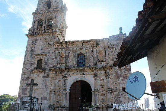 Mazatlan Tours: Old church in Copala, Mexico contrasts with satellite dish.