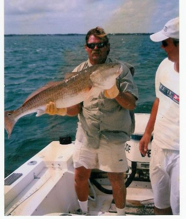 Jim with a nice kingfish skipper sportfishing for Sebastian fishing charters