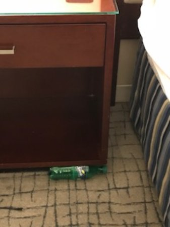 Crowne Plaza Times Square Manhattan: After housekeeping left, someone's soda bottle (it was not ours) was left by the bed...