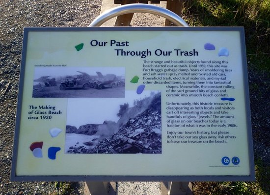 A sign that tells the history of Glass Beach, found on the trail above the beach.