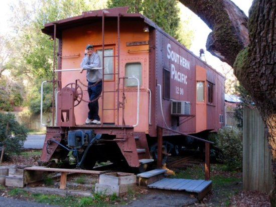 Nice, CA: My husband is standing in front of the Celebration Caboose we stayed in..