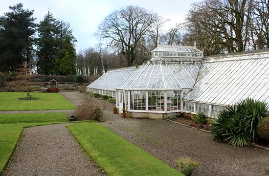 Ballantrae, UK : Part of the garden, here you see the greenhouse and the herbsgarden.