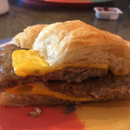 Sellersburg, IN : Croissant breakfast sandwich with sausage, cheese, and an egg.