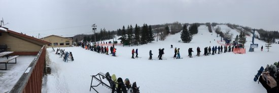 La Riviere, Canada: The mile long line for the chair lift and view from inside the bar.
