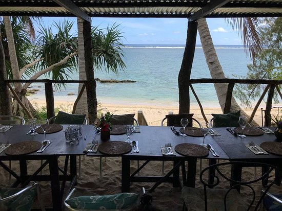 Beach Cocomo Cafe': The table layout and view for the reheasal dinner/traditions night.
