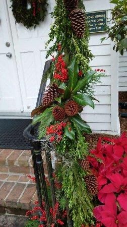 Christ Church: Greenery, pine cones and berries adorn the church handrail