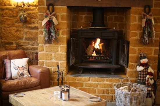 Kislingbury, UK: Come and snuggle up by our cosy log burner