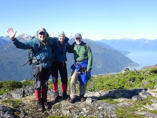 Pemberton, Canada: Happy Hikers enjoy day hiking in the alpine of the Coast Mountains in the Great Bear Rainforest