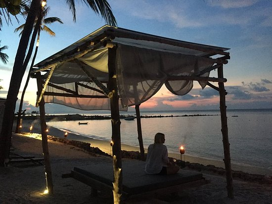 Belmond Napasai: Beach at sunset.