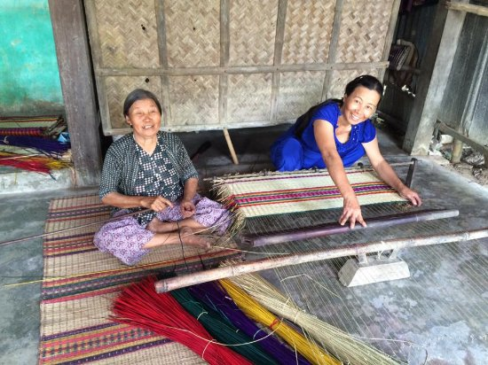 Heaven and Earth Bicycle Tours: One of the many stops to watch ladies weave grass mats