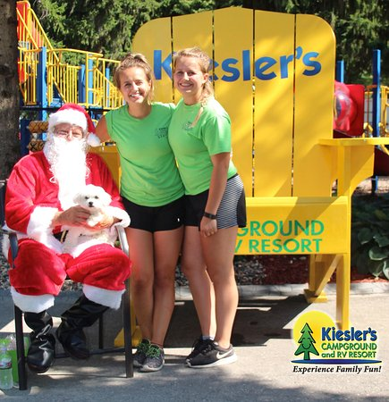 Waseca, MN: Our Amazing Activities Directors posing for a snapshot with Santa at Christmas in July at Kiesle