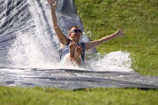 Waseca, MN: Adults love our giant slip-n-slide, too!!
