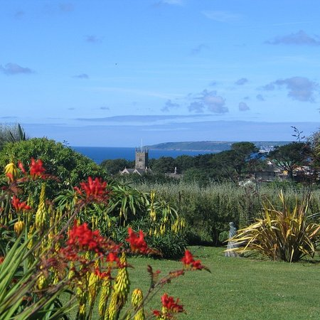 Perranuthnoe, UK: Ednovean Farm has lovely views over  sub tropical gardens to the sea
