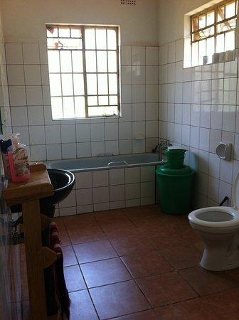 The 10-bed dorm has a big bathroom