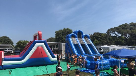 Holiday Trav-L-Park Resort: Our inflatable water slides and obstacle course. Count me in!
