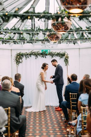 Ceremony in the conservatroy (Courtesy Maytree Photography)