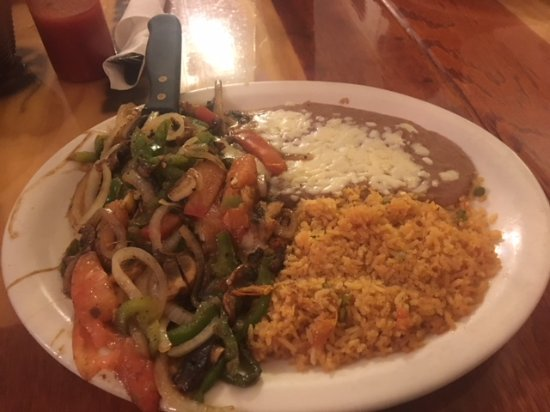 El Jimador: My plate of Santa Fe chicken with rice. It was so delicious I could not help eat it all.