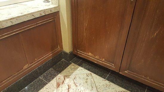 Wood peeling on bathroom vanity and bath surround - Picture of Hyatt ...